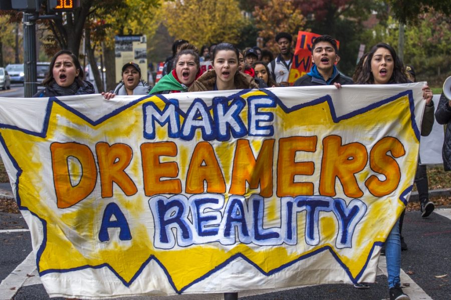 Protesters+marching+down+the+street+with+a+banner+that+reads%2C+%22Make+Dreamers+a+Reality.%22+%0A